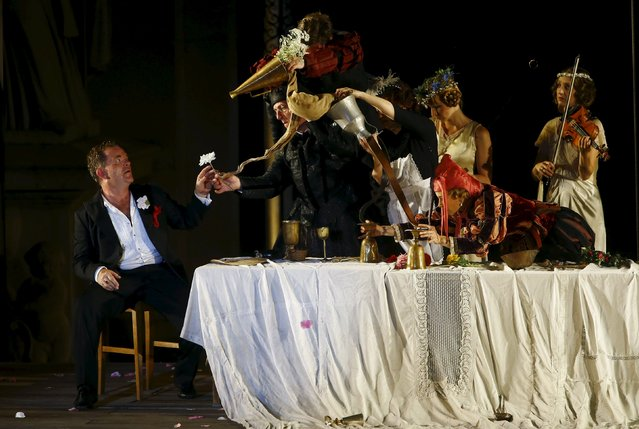 "Actor Cornelius Obonya as Jedermann (L) performs on stage during a dress rehearsal of Hugo von Hofmannsthal's drama ""Jedermann"" (Everyman) at Domplatz square in Salzburg, Austria, July 16, 2015. (Photo by Leonhard Foeger/Reuters)"