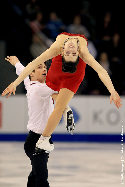 Tessa Virtue and Scott Moir of Canada compete in the Free Dance during the ISU Four Continents Figure Skating Championships at World Arena