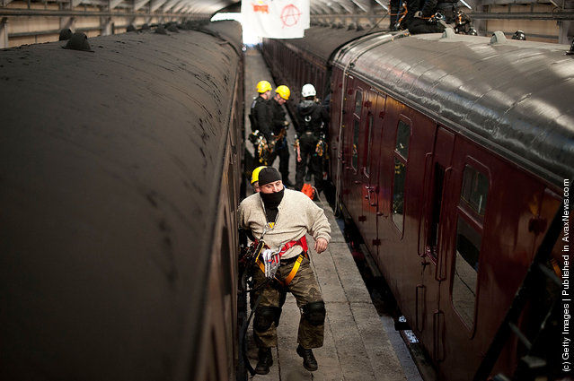 Police take part in a role play exercise as they clear a protest on top of a train during training in Oxenhope, England