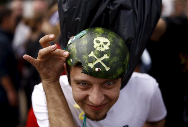 A man shows his watermelon hat during the 21st Woodstock Festival in Kostrzyn-upon-Odra, Poland July 31, 2015. (Photo by Kacper Pempel/Reuters)