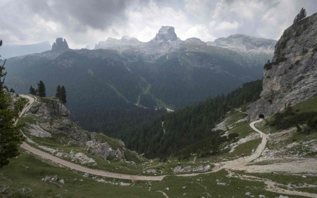 A trail winds up a hill in the Dolomite Mountains near Cortina d' Ampezzo in northern Italy July 16, 2015. (Photo by Bob Strong/Reuters)