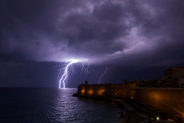 A lightning bolt strikes the sea near Fort St Elmo during a storm in Valletta, Malta on February 27, 2019. (Photo by Darrin Zammit Lupi/Reuters)
