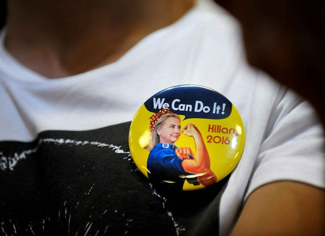 A supporter of presumptive Democratic presidential nominee Hillary Clinton wears a campaign pin during a campaign event at the North Carolina State Fairgrounds on June 22, 2016 in Raleigh, North Carolina. Clinton discussed her vision for America in the future and the issues she would tackle if elected president. (Photo by Sara D. Davis/AFP Photo)