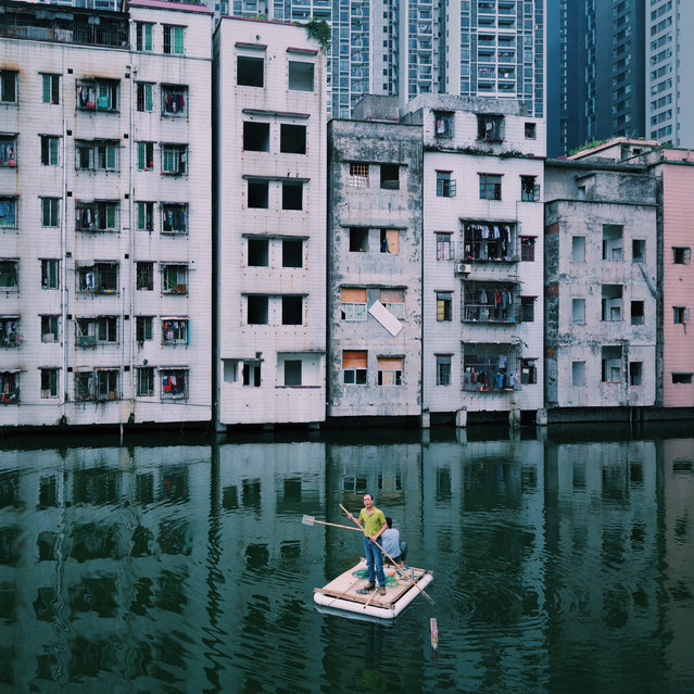 Shortlisted: Yuyang Liu. Two men were fishing in the pond of Xian village, in the centre of Guangzhou city, Guangdong, China, which epitomises China's modern urbanisation. (Photo by Yuyang Liu/2016 EPOTY)