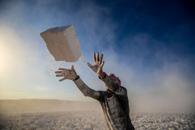 """A labourer works at the """"White Mountain"""" limestone extraction quarry site near Egypt's southern city of Minya, some 265 kilometres south of the capital, on December 7, 2019. (Photo by Khaled Desouki/AFP Photo)"""