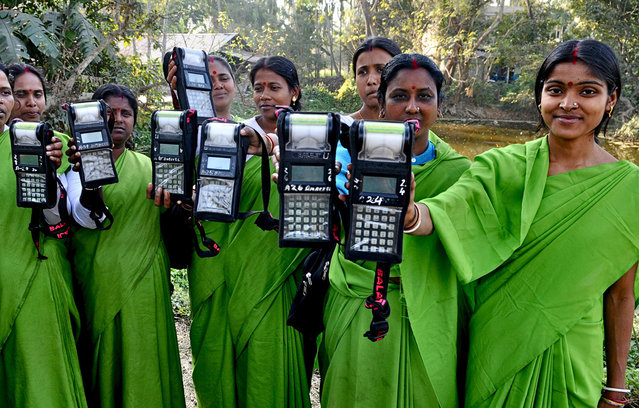 CGAP Photo Contest – Innovation of Microfinance, India. Women agents of a microcredit institution show their daily collection which is recorded in an electronic device. A microcredit initiative that took off about 17 years ago has empowered over 24,400 women in this block about 80 kms away from Kolkata, transforming their economic and social status. (Photo by Sudipto Das)