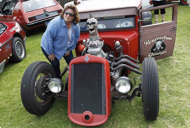 A woman poses with a 1933 Chevy Ratrod during the Concours d'Lemons car show in Seaside, California, August 16, 2014. (Photo by Michael Fiala/Reuters)