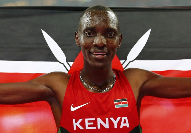 Asbel Kiprop of Kenya celebrates after winning the men's 1500 metres final during the 15th IAAF World Championships at the National Stadium in Beijing, China, August 30, 2015. (Photo by Damir Sagolj/Reuters)