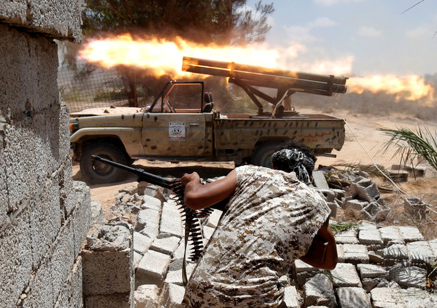 Libyan forces allied with the U.N.-backed government fire weapons during a battle with IS fighters in Sirte, Libya, July 21, 2016. (Photo by Goran Tomasevic/Reuters)