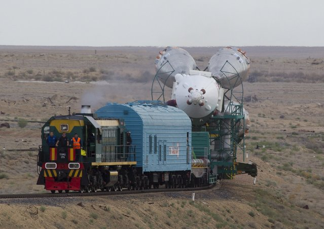 The Soyuz TMA-18M spacecraft is transported from an assembling hangar to its launch pad at the Baikonur cosmodrome, Kazakhstan, August 31, 2015. (Photo by Shamil Zhumatov/Reuters)