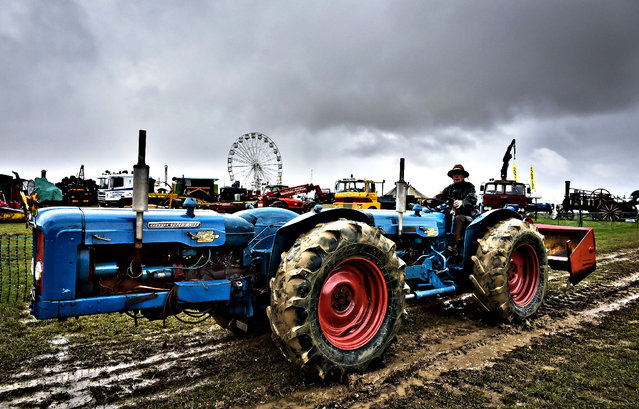 A double Fordson tractor at the Great Dorset Steam Fair on August, 26, 2014, where hundreds of period steam traction engines and heavy mechanical equipment are being set up for the annual Dorset gathering of steam enthusiasts. (Photo by Ben Birchall/PA Wire)