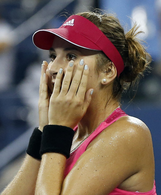 Belinda Bencic, of Switzerland, reacts after her upset victory over Jelena Jankovic, of Serbia, in the fourth round of the 2014 U.S. Open tennis tournament, Sunday, August 31, 2014, in New York. (Photo by Elise Amendola/AP Photo)