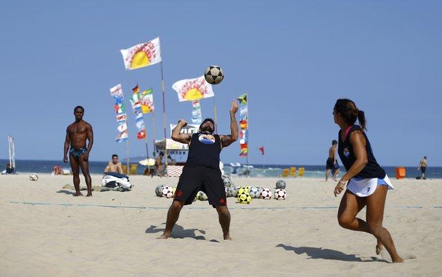 2016 Rio Olympics, Olympic Park on July 29, 2016. People play football on the beach. (Photo by Ivan Alvarado/Reuters)
