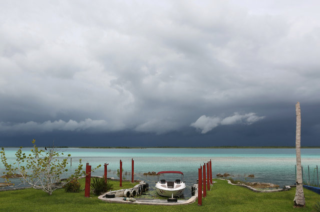 A boat is seen on the beach as storm clouds brought by Hurricane Earl approaches the beach resort of Chetumal, Mexico, August 3, 2016. (Photo by Lorenzo Hernandez/Reuters)