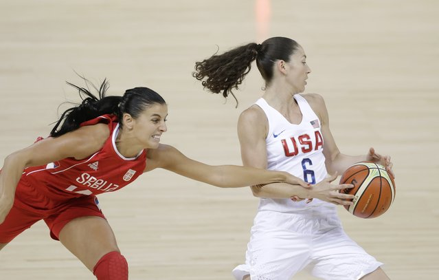 Serbia guard Ana Dabovic reaches in and fouls United States guard Sue Bird (6) during the first half of a women's basketball game at the Youth Center at the 2016 Summer Olympics in Rio de Janeiro, Brazil, Wednesday, August 10, 2016. (Photo by Carlos Osorio/AP Photo)