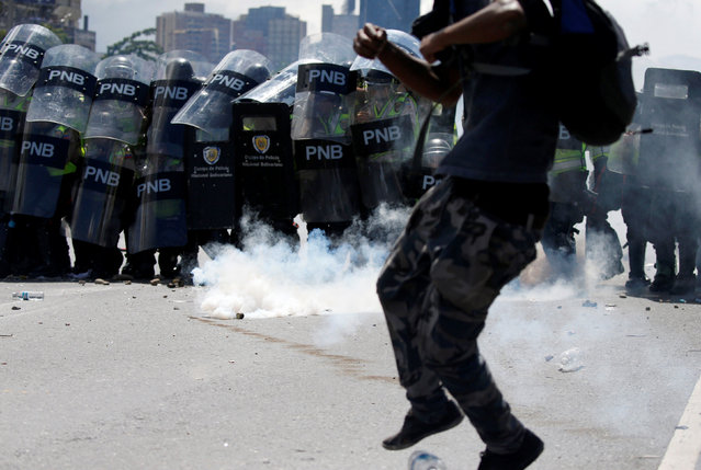 A protester clashes with the police during a rally to demand a referendum to remove Venezuela's President Nicolas Maduro in Caracas, Venezuela, September 1, 2016. (Photo by Carlos Garcia Rawlins/Reuters)