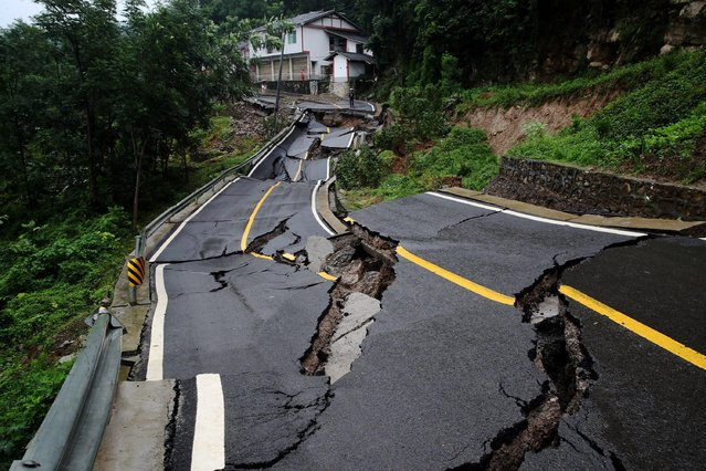 Road subsidence caused by continuous rainstorm is pictured in Chongqing, China, 4 July 2020. (Photo by Reuters/China Daily)