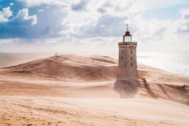 Rubjerg Knude lighthouse, northern Jutland, Denmark. This lighthouse was built on the top of a cliff in 1900 and ceased operating in 1968. With coastal erosion and continually shifting sands a major problem in the area, it is anticipated that by 2023 the cliff will have been eroded so far that the lighthouse will fall into the sea. (Photo by Elisabeth Coelfen/Dreamstime)