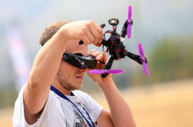 A drone pilot prepares his drone before the first SPARK Multirotor Challenge in Mostar, Bosnia and Herzegovina September 10, 2016. (Photo by Dado Ruvic/Reuters)