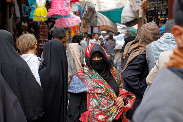 A woman walks in the old market, ahead of the Eid Al-Adha festival, in the historic city of Sanaa, Yemen September 11, 2016. (Photo by Mohamed al-Sayaghi/Reuters)