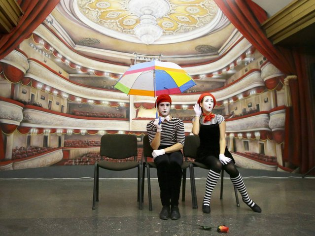 "Ukrainian artists perform in front of a newly opened 3D picture showing interior of a theater, on a place, where previously Lenin's bust was hanging', at the subway station ""Teatralnaya"" (Theater) in Kiev, Ukraine, 06 November 2014. Kiev's subway was opened on 06 November 1960. (Photo by Tatyana Zenkovich/EPA)"