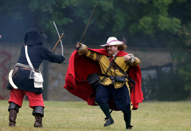 Participants wearing medieval costumes re-enact the 1620 battle of Bila Hora between Bohemian Estates and Austrian Imperial with Catholic forces in Prague, Czech Republic September 18, 2016. (Photo by David W. Cerny/Reuters)