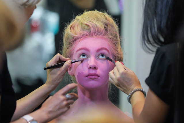 Models get their makeup backstage during the Ukrainian Fashion Week in Kiev, Ukraine, 01 September 2020. The fashion event presents 2020/21 collections by Ukrainian and international designers and will run until 03 September 2020. (Photo by  Sergey Dolzhenko/EPA/EFE)
