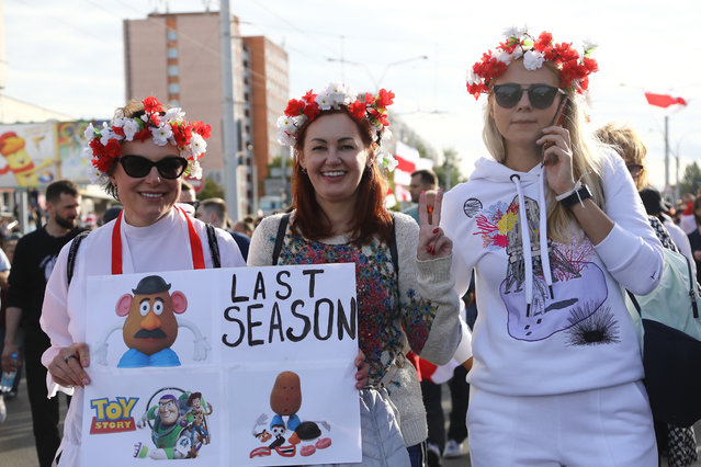 Women with a wreath on their heads pose for a photo during a Belarusian opposition supporters' rally protesting the official presidential election results in Minsk, Belarus, Sunday, September 13, 2020. Protests calling for the Belarusian president's resignation have broken out daily since the Aug. 9 presidential election that officials say handed him a sixth term in office. (Photo by TUT.by via AP Photo)
