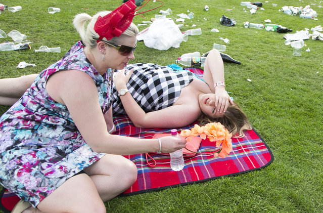 Mandatory Credit: Photo by Asanka Brendon Ratnayake/REX (4230411bs)  Two friends rest on the lawn at the conclusion of the races during the Emirates Melbourne Cup Day held at Flemington Racecourse in Melbourne Australia.