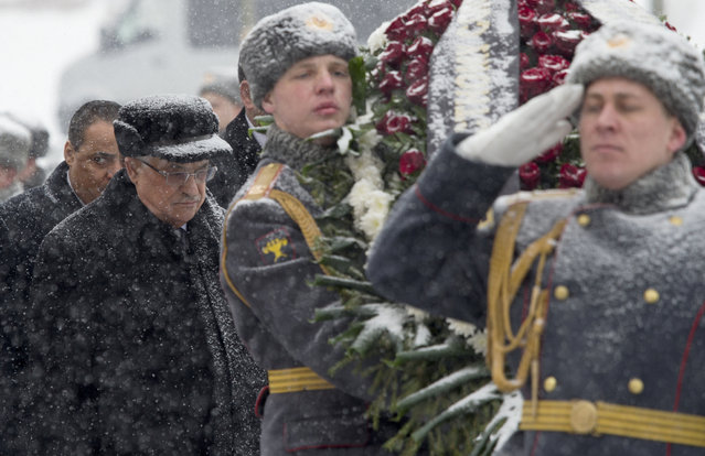Snow falls as Palestinian President Mahmoud Abbas, left, attends a wreath laying ceremony at the Tomb of Unknown Soldier in Moscow, Russia, Thursday, March 14, 2013. (Photo by Misha Japaridze/AP Photo)
