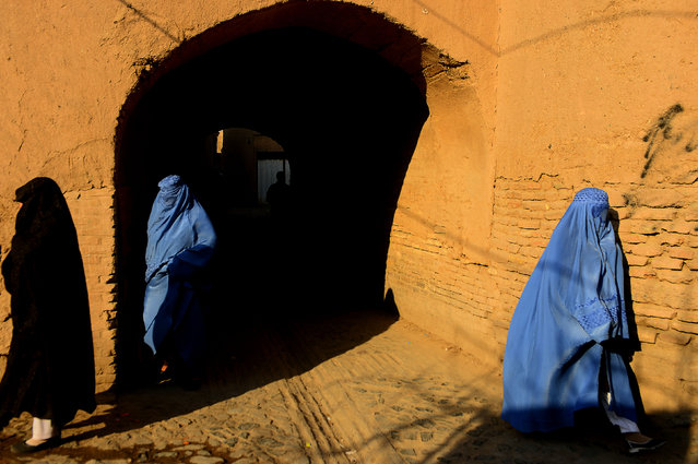 This photograph taken on January 9, 2018 shows burqa-clad Afghan women walking in the old part of Herat. (Photo by Hoshang Hashimi/AFP Photo)