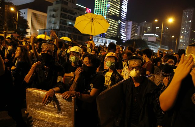 Pro-democracy protesters wearing goggles and masks block a road outside the chief executive office during a rally in Hong Kong, November 30, 2014. (Photo by Bobby Yip/Reuters)