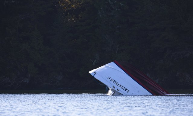 Capsized whale watching boat Leviathan 2 sits in a bay after being towed from where it sank in Tofino, British Columbia October 26, 2015. A tour boat with 27 passengers on board sunk off the coast of British Columbia, killing an unknown number of people, rescue officials said on Sunday. A search for survivors is ongoing, according to the Joint Rescue Victoria Coordination Centre in Tofino, British Columbia. (Photo by Kevin Light/Reuters)