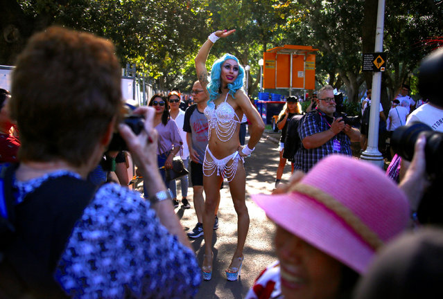 A participant wearing a costume poses for members of the public before the 40th anniversary of the Sydney Gay and Lesbian Mardi Gras Parade in central Sydney, Australia, March 3, 2018. (Photo by David Gray/Reuters)