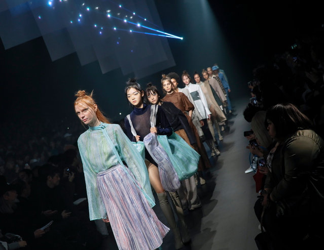 """Model present creations from the Autumn/Winter 2018 collection by Japanese designers Sho Iwata and Hiroshi Takizawa for the label """"tiit tokyo"""" at the grand finale during the Tokyo Fashion Week, in Tokyo, Japan, 19 March 2018. The presentation of the Fall/Winter 2018 collections runs from 19 to 24 March. (Photo by Kimimasa Mayama/EPA/EFE)"""