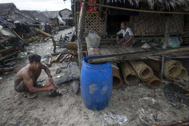 A family passes the time at their home in Kyaukpyu township, Rakhine state, Myanmar October 6, 2015. (Photo by Soe Zeya Tun/Reuters)