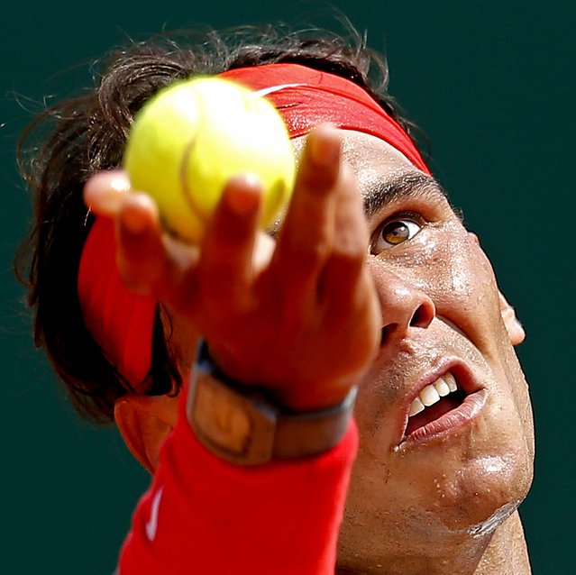 Spain's Rafael Nadal serves the ball to Marinko Matosevic of Australia during their match of the Monte Carlo Tennis Masters tournament in Monaco, on April 17, 2013. (Photo by Lionel Cironneau/Associated Press)