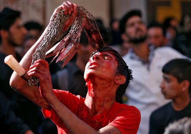 A Kashmiri Shi'ite Muslim mourner flagellates himself during a Muharram procession to mark Ashura in Srinagar, India October 12, 2016. (Photo by Danish Ismail/Reuters)