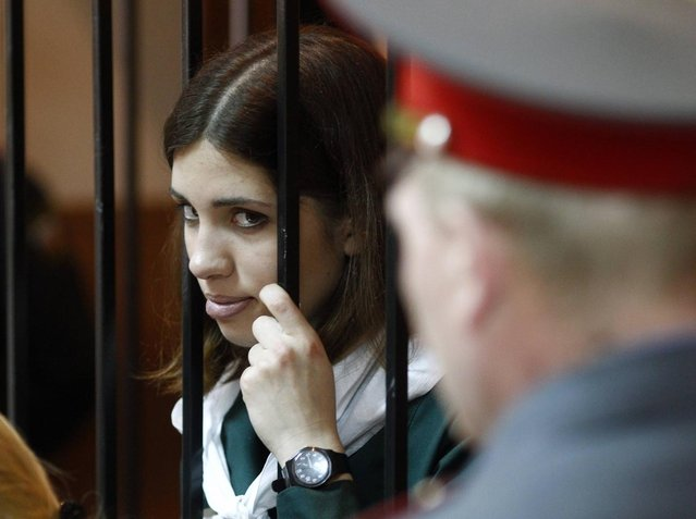 p*ssy Riot band member Nadia Tolokonnikova looks out from a holding cell during a court hearing in the town of Zubova Polyana April 26, 2013. Tolokonnikova is appealing her conviction for hooliganism motivated by religious hate for which she is serving two years in a remote penal colony. (Photo by Mikhail Voskresensky/Reuters)