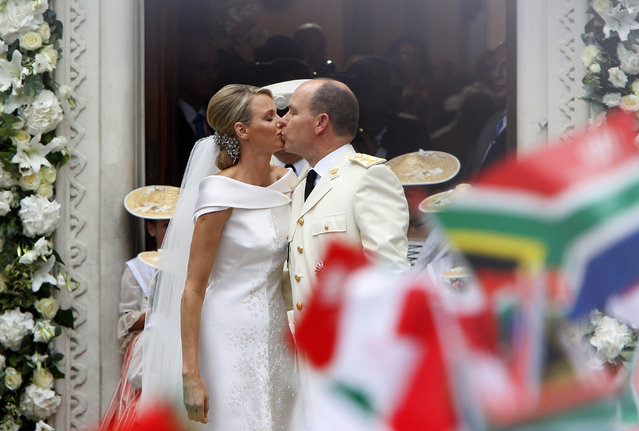 Princess Charlene and Monaco's Prince Albert II kiss outside the Sainte Devote church in Monaco after their religious wedding ceremony in Monaco, July 2, 2011. (Photo by Francois Mori/Reuters/Pool)