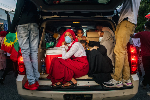 Demonstrators sit in the back of a trunk during a protest after the death of musician and activist Hachalu Hundessa on July 1, 2020 in St Paul, Minnesota. Hundessa, known for his protest songs which resonated within the Oromo ethnic group, was shot and killed in Ethiopia's capital Addis Ababa on June 29, 2020. His death has sparked ongoing protests around the world. (Photo by Brandon Bell/Getty Images)