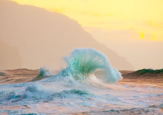 """Green Glow"". Kauai is a wild and magical place. It invokes a sense of freedom, appreciation, and love. At this particular beach waves rebound and crash off of lava rocks and cliffs forming into interesting shapes. Location: Kauai, Hawaii. (Photo and caption by Lace Andersen/National Geographic Traveler Photo Contest)"