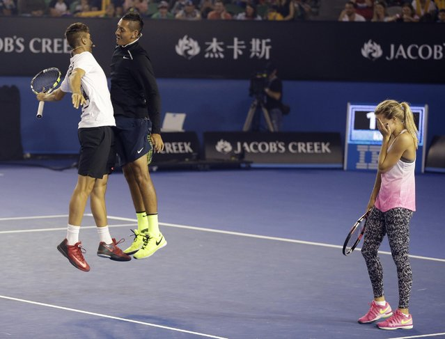 Canada's Eugenie Bouchard reacts as Australian players Nick Kyrgios and Thanasi Kokkinakis, left, celebrate a point win during the Kids Tennis Day event on Rod Laver Arena ahead of the Australian Open tennis championship in Melbourne, Australia, Saturday, January 17, 2015. (Photo by Mark Baker/AP Photo)