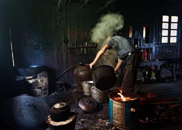 """Working on Tofu"". Man Making Tofu at Longseng village Guilin, China. (Photo and caption by Helminadia Jabur/National Geographic Traveler Photo Contest)"