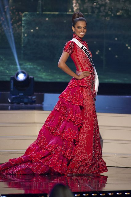 Rathi Menon, Miss Singapore 2014 competes on stage in her evening gown during the Miss Universe Preliminary Show in Miami, Florida in this January 21, 2015 handout photo. (Photo by Reuters/Miss Universe Organization)