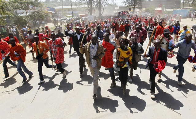 Residents chant slogans during protests to oust the Narok county Governor Samuel Tunai in Narok, Kenya, January 26, 2015. (Photo by Thomas Mukoya/Reuters)