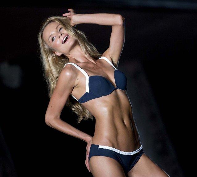 A model walks the runway wearing Barraca Chic swimwear. (Photo by J. Pat Carter/Associated Press)