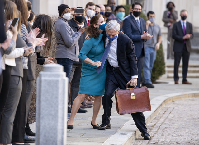 President Joe Biden's pick for attorney general Merrick Garland, hugs his wife Lynn as he arrives for his first day at the Department of Justice, Thursday, March 11, 2021,  in Washington. Garland, a one time Supreme Court nominee under President Obama, was confirmed Wednesday by a Senate and will be sworn in later today. (Photo by Kevin Dietsch/Pool via AP Photo)