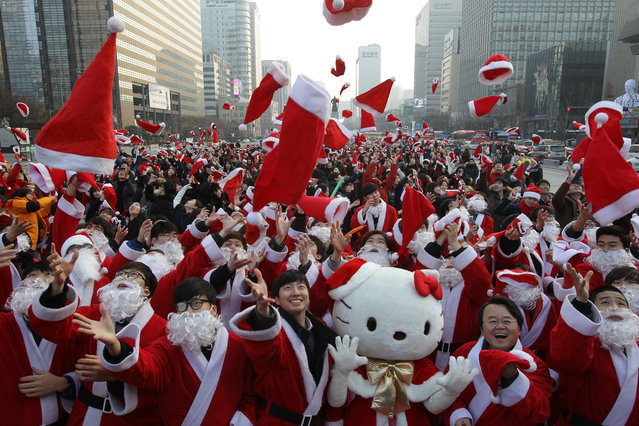South Koreans wearing Santa Claus outfits attend an event to promote Christmas at a charity event on December 24, 2015 in Seoul, South Korea. The event was organized to prepare and deliver gifts for the poor. Christmas has become increasingly popular over the years in South Korea, which is the only East Asian country to recognize Christmas as a national holiday.  (Photo by Chung Sung-Jun/Getty Images)