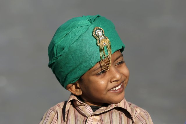 A boy sports a religious motif on his turban while taking part in a procession to mark Eid-e-Milad-ul-Nabi, or birthday celebrations of Prophet Mohammad, in Karachi, Pakistan, December 24, 2015. (Photo by Akhtar Soomro/Reuters)